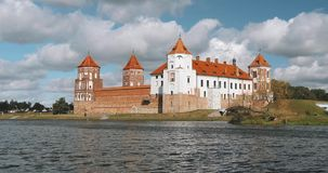Mir, Belarus. Mir Castle Complex From Side Of Lake. UNESCO World Heritage Site. Famous Landmark In Summer Sunny Day. Mir, Belarus. Mir Castle Complex From Side stock footage
