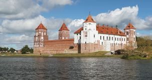 Mir, Belarus. Mir Castle Complex From Side Of Lake. UNESCO World Heritage Site. Famous Landmark In Summer Sunny Day. Mir, Belarus. Mir Castle Complex From Side stock video footage