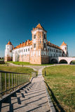 Mir, Belarus. Towers Of Mir Castle Complex On Blue Sunny Sky Background. Architectural Ensemble Of Feudalism Stock Photos