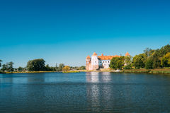 Mir, Belarus. View Of Mir Castle Complex, Ancient Monument, Unesco Heritage. Mir, Belarus. Scenic View Of Mir Castle Complex From Side Of Lake. Architectural Stock Image