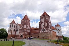 Mir Castle on the background of blue sky with clouds summer day, Belarus stock image