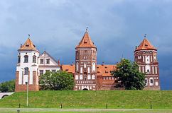 Mir Castle on the background of a stormy sky Stock Image