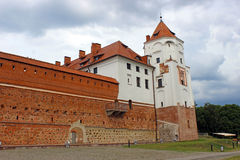 Mir Castle on the background of a stormy sky. In Belarus Stock Photos