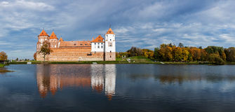 Mir castle in Belarus. Travel belarus background - Medieval Mir castle famous landmark in town Mir, Belarus reflecting in lake Stock Image