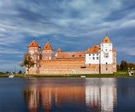 Mir castle in Belarus. Travel belarus background - Medieval Mir castle famous landmark in town Mir, Belarus reflecting in lake Royalty Free Stock Photography