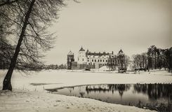 The Mir Castle. winter. Belarusian attraction Mir Castle covered with snow in the winter season. retro style royalty free stock image