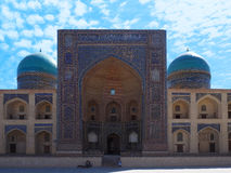 Mir-i-Arab Mosque: entrance door and walls in cyan, blue and turquoise mosaics royalty free stock image