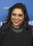 """Mira Nair. Director/filmmaker Mira Nair arrives on the red carpet for the New York premiere of """"Olive Kitteridge.""""  This is a 4-part drama series on HBO, the Royalty Free Stock Photo"""