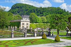Mirabell Palace and Gardens in Salzburg, Austria. Salzburg, Austria - May 23, 2018 : people walk among flower beds in the Mirabell park in Salzburg royalty free stock images