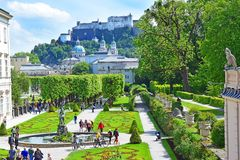 Mirabell Palace and Gardens in Salzburg, Austria. Salzburg, Austria - May 23, 2018 : people walk among flower beds in the Mirabell park in Salzburg, old historic royalty free stock photos