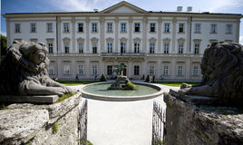 The Mirabell palace guarded by lions. The baroque Mirabell palace with gate guarded by lions in Salzburg/Austria stock photo