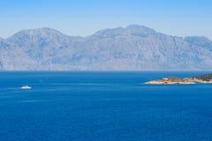 Mirabello bay. Crete, Greece. White boat in Mirabello bay. Crete, Greece Royalty Free Stock Photo