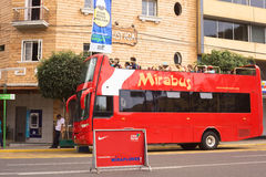 Mirabus Sightseeing Bus in Miraflores, Lima, Peru. LIMA, PERU - APRIL 1, 2012: Unidentified people on Mirabus sightseeing bus in front of the restaurant Rustica Royalty Free Stock Photography