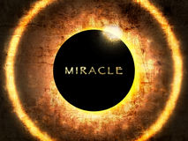 Miracle. A eclipse background with miracle word Stock Photo