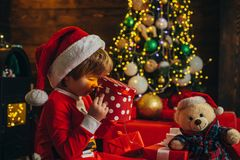 It is miracle. Boy cute child cheerful mood play near christmas tree. Merry and bright christmas. Santa boy little child stock photography