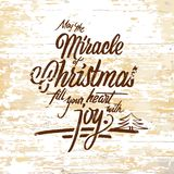 Miracle Christmas lettering on wooden background. Vector illustration drawn by hand stock illustration