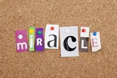Miracle. Cut out single letters stock image