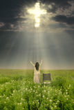 Miracle does happen. Woman with wheelchair is being healed by God. Shot in meadow Royalty Free Stock Photo
