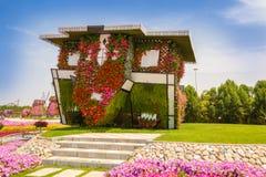 Miracle garden. DUBAI, UAE - MARCH 28: Upside down house in Dubai Miracle Garden in the UAE on March 28, 2015. It has over 45 million flowers stock photos