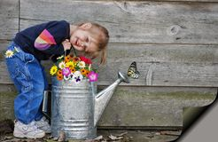 Little girl with watering can Royalty Free Stock Image