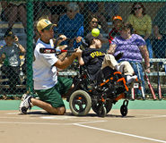 Miracle League Softball for Handicapped Children. Cumming, GA, USA - Unidentified player and coach on a team in the Miracle League in Cumming, Georgia, April 14 Royalty Free Stock Photography