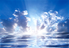 Miracle light sky. Light shinning from the center with water reflection Stock Photos