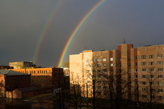 Miracle rainbow above the city. Miracle rainbow and dark sky above the buildings of the city. Saint-Petersburg Stock Photography