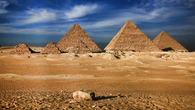 Miracle of the world. Near to the city of Cairo, in Sinai desert, against the pure blue sky and clouds, pyramids of Hiopsa, an ancient miracle of the world have royalty free stock photography