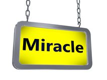 Miracle on billboard. Miracle on yellow light box billboard on white background Royalty Free Stock Photography