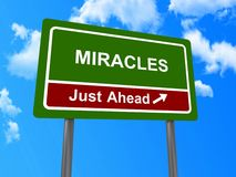 Miracles just ahead sign. With directional arrow, religious concept with blue sky and cloudscape background stock photos