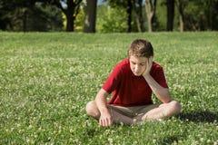 Mirada adolescente triste abajo Fotos de archivo