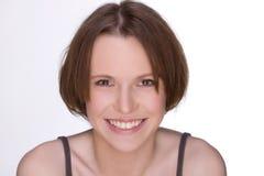 Mirada de la muchacha con una sonrisa Fotos de archivo libres de regalías