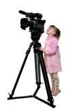 Mirada de la muchacha en la videocámara Fotografía de archivo