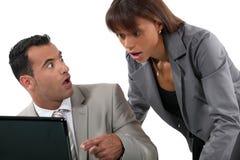 Mirada de los oficinistas chocada Fotografía de archivo libre de regalías