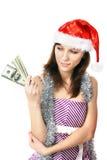 Mirada de Papá Noel de la muchacha en el dinero Fotografía de archivo libre de regalías