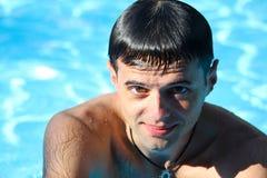 Mirada del hombre en agua azul Imágenes de archivo libres de regalías