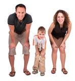 Mirada del padre, de la madre y del hijo que dobla abajo Fotos de archivo