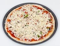 Mirada final de la preparación de la pizza fotografía de archivo libre de regalías