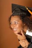 Mirada graduada sonriente hacia espacio de la copia Fotografía de archivo
