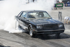 Mirada smoke show. Napierville dragway august 22, 2015 picture of black dodge mirada making a smoke show on the track at john scotti all out event Stock Image