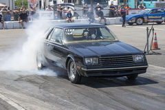 Drag racing. NHRA National Open July 12–13-14, 2015, front side view of dodge mirada making a burnout on the race track Royalty Free Stock Images