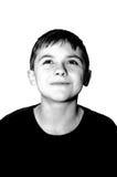 Mirada sonriente del muchacho de la edad de escuela para arriba Fotos de archivo libres de regalías