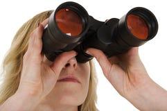 Mirada a través de los prismáticos Fotografía de archivo libre de regalías