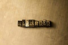 MIRADO - el primer del vintage sucio compuso tipo de palabra en el contexto del metal Imagen de archivo libre de regalías