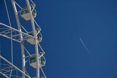The Mirador Princess. A ferris wheel in Avenida de Aragón, Valencia and an airplane passing in the sky Stock Images