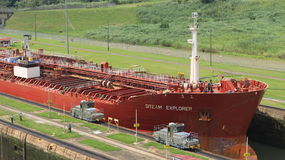 Red large cargo ship entering Miraflores Locks Royalty Free Stock Images