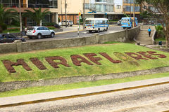 Miraflores Sign on the Lawn in Lima, Peru. LIMA, PERU - MARCH 24, 2012: The name of the district of Miraflores written with plants along the roadside of Malecon Stock Photos