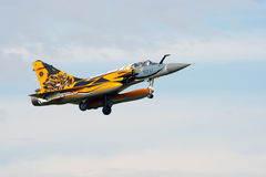 Mirage 2000. VOLKEL, THE NETHERLANDS - OCTOBER 4: Special painted French Air Force Mirage 2000 jetfighter arriving at the NATO Tigermeet 2010 October 4, 2010 in Stock Image