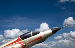 Mirage. Fighter on a blue cloudy sky Stock Image