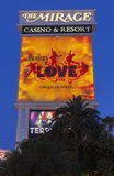 The Mirage Hotel Sign with the Beatles Love in Las Vegas, NV on Stock Image